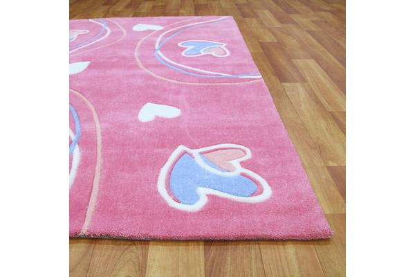 Hearts And Swirls Pink Children's Rug 165x115cm
